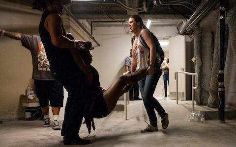 <span>A wounded woman is taken to the neighbouring Tropicana basement during the incident</span> <span>Credit: Chase Stevens/Las Vegas Review-Journal/AP </span>