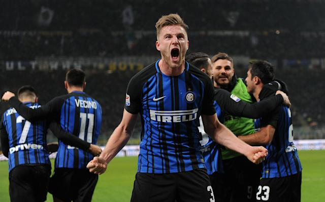Soccer Football - Serie A - Inter Milan vs Benevento Calcio - San Siro, Milan, Italy - February 24, 2018 Inter Milan's Milan Skriniar celebrates scoring their first goal with team mates REUTERS/Massimo Pinca