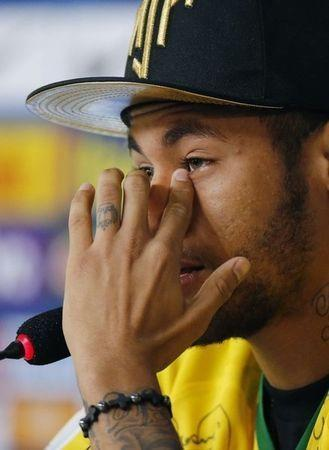 Injured Brazilian national soccer team player Neymar cries during a news conference in Teresopolis, near Rio de Janeiro, July 10, 2014. REUTERS/Marcelo Regua