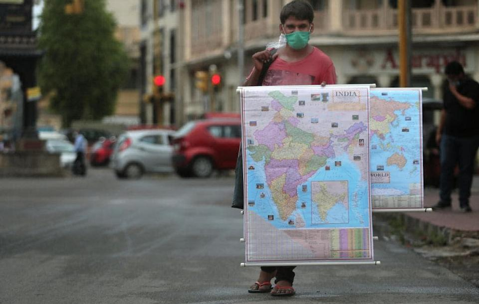 A street vendor selling maps - getty