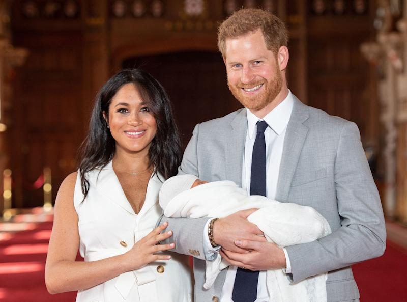 Prince Harry and Duchess Meghan of Sussex pose with their newborn son, Archie Harrison Mountbatten-Windsor, in St George's Hall at Windsor Castle, May 8, 2019.