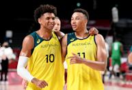 <p>SAITAMA, JAPAN - JULY 25: Matisse Thybulle and Dante Exum of Australia celebrate victory after the preliminary rounds of the Men's Basketball match between Australia and Nigeria on day two of the Tokyo 2020 Olympic Games at Saitama Super Arena on July 25, 2021 in Saitama, Japan. (Photo by Bradley Kanaris/Getty Images)</p>
