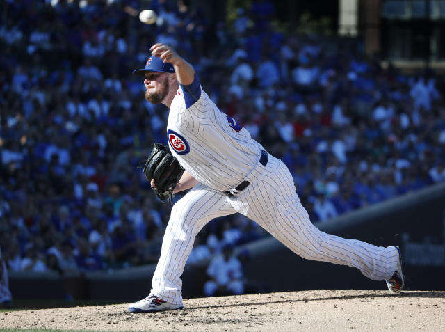 Chicago Cubs starting pitcher Jon Lester delivers during the fourth inning of a baseball game against the Cincinnati Reds, in Chicago, on Saturday, Sept. 15, 2018. (AP Photo/Jeff Haynes)
