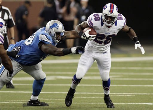 Buffalo Bills running back C.J. Spiller (28) escapes from Detroit Lions defensive tackle Nick Fairley (98) in the first quarter of their NFL preseason football game in Detroit, Thursday, Aug. 30, 2012. (AP Photo/Duane Burleson)