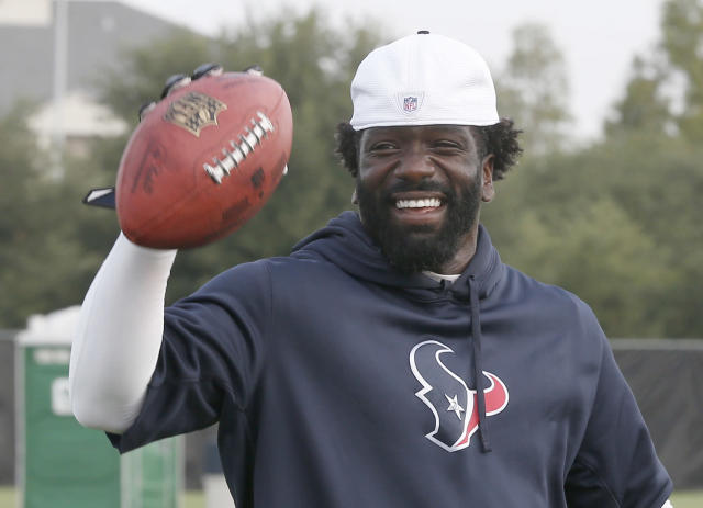 Houston Texans free safety Ed Reed smiles as he tosses back a football during the team's NFL football training camp Saturday, July 27, 2013, in Houston. A standout All-Pro, Reed joined the Texans after last season's Super Bowl run in Baltimore. (AP Photo/Pat Sullivan)