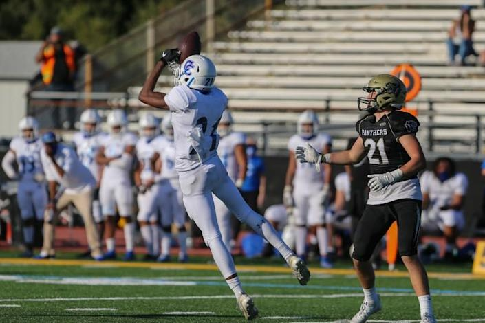 ROLLING HILLS ESTATES, CA - APRIL 02: Culver City free safety Prince Okorie (21) intercepts a pass in a 0-49 win over Peninsula Palos Verdes on Friday, April 2, 2021 in Rolling Hills Estates, CA. (Jason Armond / Los Angeles Times)
