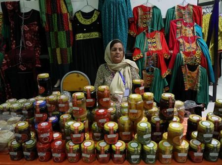 Afghan woman vendor waits for customers during a women ability exhibition in Kabul