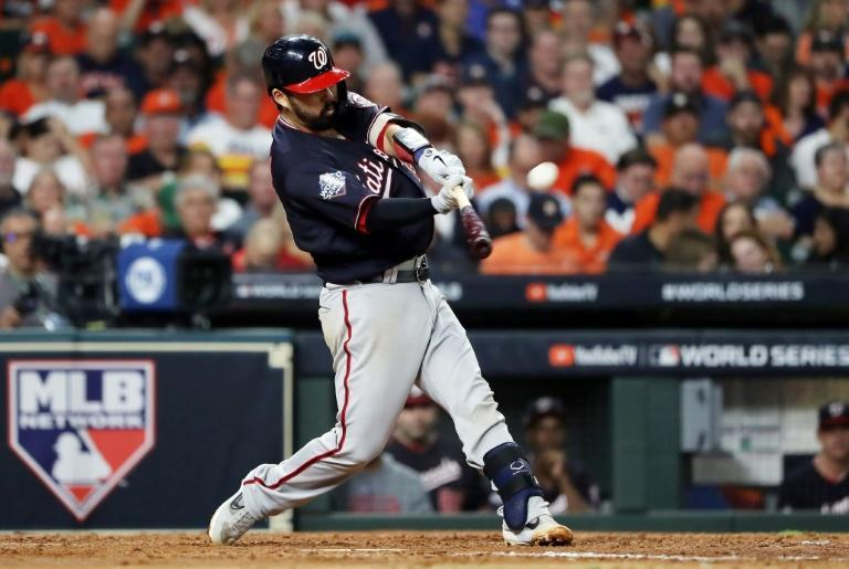 Washington's Kurt Suzuki hits a solo home run in the Nationals' 12-3 victory over the Houston Astros in game two of Major League Baseball's 2019 World Series (AFP Photo/ELSA)