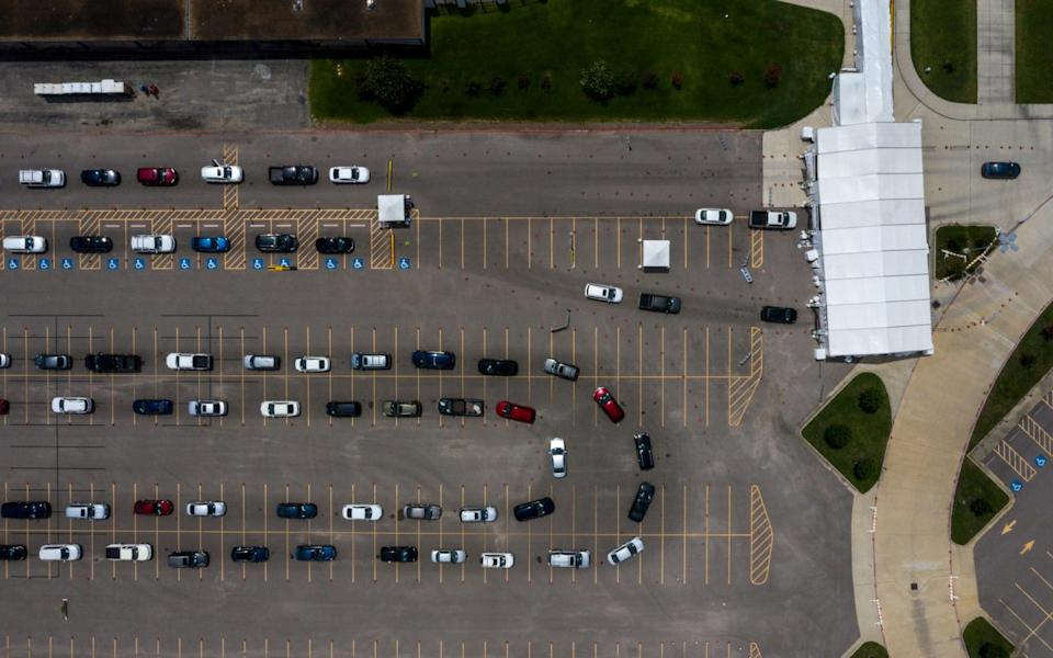 Residents line-up in their vehicles to be tested in Houston, Texas - Reuters