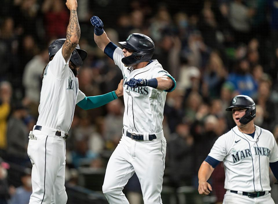 Mitch Haniger celebrates a home run against Oakland with J.P. Crawford.