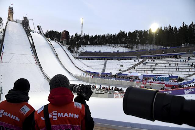 Lahti Ski Games - FIS Nordic World Cup - Men's Ski Jumping - Lahti, Finland - March 4, 2018. Photographers observe the men's ski jumping competition. LEHTIKUVA/Markku Ulander via REUTERS ATTENTION EDITORS - THIS IMAGE WAS PROVIDED BY A THIRD PARTY. NO THIRD PARTY SALES. NOT FOR USE BY REUTERS THIRD PARTY DISTRIBUTORS. FINLAND OUT. NO COMMERCIAL OR EDITORIAL SALES IN FINLAND.