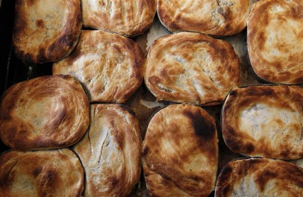 A tray of traditional British meat pies. Photographed at G. Kelly's pie and mash shop in east London.