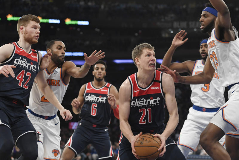 Washington Wizards forward Moritz Wagner (21) drives toward the basket as New York Knicks center Mitchell Robinson (23) and guard Wayne Ellington (2) defend during the first half of an NBA basketball game, Wednesday, Feb. 12, 2020, in New York. (AP Photo/Sarah Stier)