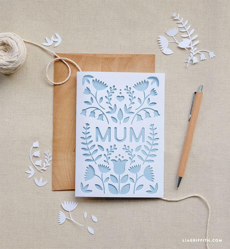 """<p>Love using a paper cutter? Try recreating this cute floral design cut-out card.</p><p><strong>Get the tutorial at <a href=""""https://go.redirectingat.com?id=74968X1596630&url=https%3A%2F%2Fliagriffith.com%2Fuk-mothers-day-papercut-card%2F&sref=https%3A%2F%2Fwww.thepioneerwoman.com%2Fholidays-celebrations%2Fg35668391%2Fdiy-mothers-day-cards%2F"""" rel=""""nofollow noopener"""" target=""""_blank"""" data-ylk=""""slk:Lia Griffith"""" class=""""link rapid-noclick-resp"""">Lia Griffith</a>. </strong></p><p><a class=""""link rapid-noclick-resp"""" href=""""https://www.amazon.com/Cricut-PC2004195-Maker-Champagne/dp/B072VYPWM4/ref=sr_1_1_sspa?tag=syn-yahoo-20&ascsubtag=%5Bartid%7C2164.g.35668391%5Bsrc%7Cyahoo-us"""" rel=""""nofollow noopener"""" target=""""_blank"""" data-ylk=""""slk:SHOP CRICUT MAKER MACHINES""""> SHOP CRICUT MAKER MACHINES</a></p>"""