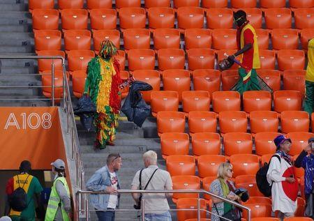Soccer Football - World Cup - Group H - Japan vs Senegal - Ekaterinburg Arena, Yekaterinburg, Russia - June 24, 2018 Senegal fans clean up after themselves after the match REUTERS/Andrew Couldridge