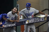 Los Angeles Dodgers starting pitcher Clayton Kershaw in the dugout with first base coach George Lobard after leaving the game during the sixth inning in Game 5 of the baseball World Series against the Tampa Bay Rays Sunday, Oct. 25, 2020, in Arlington, Texas. (AP Photo/Sue Ogrocki)