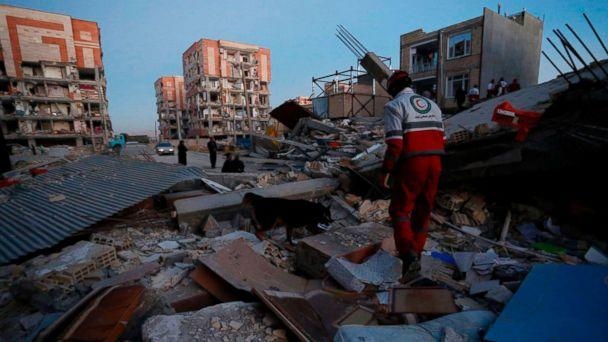 PHOTO: Rescue personnel conduct search and rescue work following a 7.3-magnitude earthquake at Sarpol-e Zahab in Iran's Kermanshah province, Nov. 13, 2017. (Pouria Pakizeh/AFP/Getty Images)
