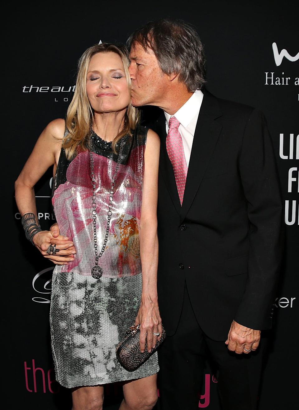 Michelle Pfeiffer, left, and husband David E. Kelley pictured in 2012.