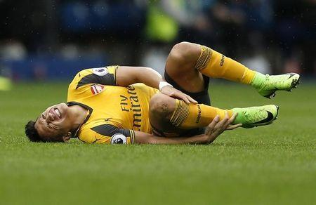 Arsenal's Alexis Sanchez goes down with an injury