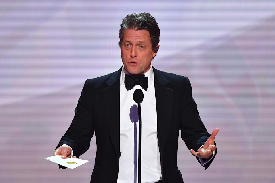 Actor Hugh Grant speaks onstage during the 25th Annual Screen Actors Guild Awards show at the Shrine Auditorium in Los Angeles on January 27, 2019. (Photo by Frederic J. BROWN / AFP)        (Photo credit should read FREDERIC J. BROWN/AFP/Getty Images)