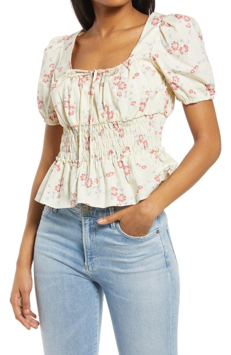 <p>The silhouette of this <span>WAYF Lucian Floral Smocked Waist Top</span> ($55) will make you feel gorgeous - just add some jeans and white sneakers.</p>