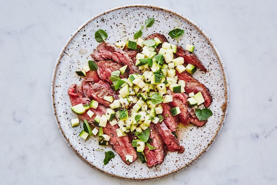 "A little meat-mallet action transforms this tough cut of beef into a quick-grilling all-star. But the simple topper, made with zucchini, red wine vinegar, and fresh oregano, may steal the show. <a href=""https://www.epicurious.com/recipes/food/views/grilled-pounded-flank-steak-with-zucchini-salsa?mbid=synd_yahoo_rss"" rel=""nofollow noopener"" target=""_blank"" data-ylk=""slk:See recipe."" class=""link rapid-noclick-resp"">See recipe.</a>"