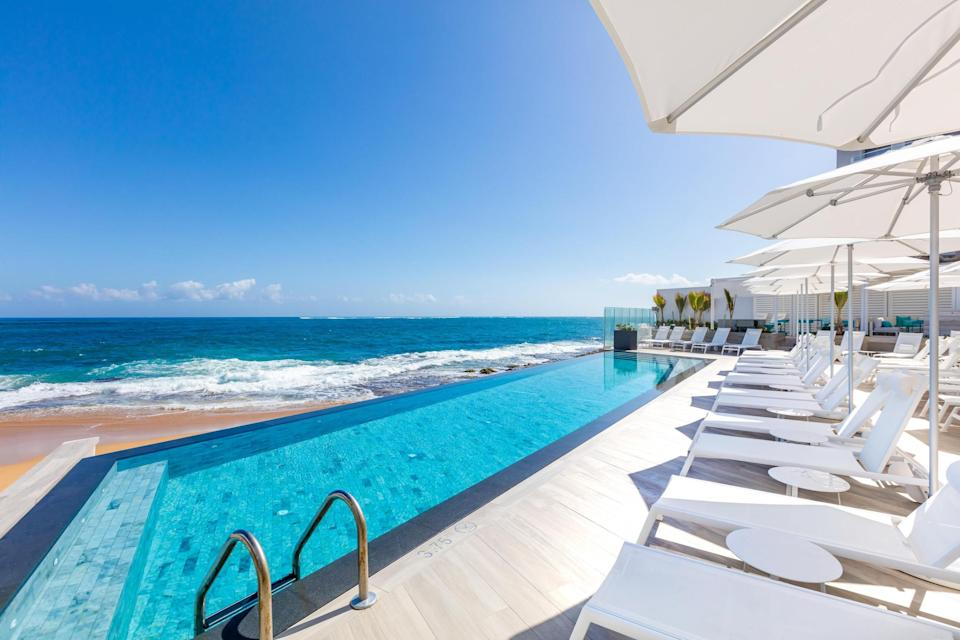 """<p>Live your best life with a cabana booking at the lively <a href=""""https://cna.st/affiliate-link/23mWWsNhhtSbaC3AdE5yUdCCua136NY6WYZoxy3gz9jm7JRk3a4VAKdWQw8vha7bBYpq2L8t5ze2q8Vz2TkfoowC?cid=607d250d7774091e06dd5d07"""" rel=""""nofollow noopener"""" target=""""_blank"""" data-ylk=""""slk:Condado Ocean Club"""" class=""""link rapid-noclick-resp"""">Condado Ocean Club</a> hotel (<em>rooms from $414</em>) in <a href=""""https://www.cntraveler.com/gallery/best-hotels-in-puerto-rico?mbid=synd_yahoo_rss"""" rel=""""nofollow noopener"""" target=""""_blank"""" data-ylk=""""slk:San Juan"""" class=""""link rapid-noclick-resp"""">San Juan</a>. The price includes a reserved cabana for six people, access to the beach (which is just steps from your cabana), and use of other hotel amenities such as the fitness center. Dedicated service tends to your every need, so that a piña colada is never out of reach.</p> <p><strong>Reserve a spot</strong>: <a href=""""https://book.daypassapp.com/pool-daypass/puerto-rico/san-juan/condado-ocean-club-cabana-day-pass/675"""" rel=""""nofollow noopener"""" target=""""_blank"""" data-ylk=""""slk:daypassapp.com"""" class=""""link rapid-noclick-resp"""">daypassapp.com</a></p>"""