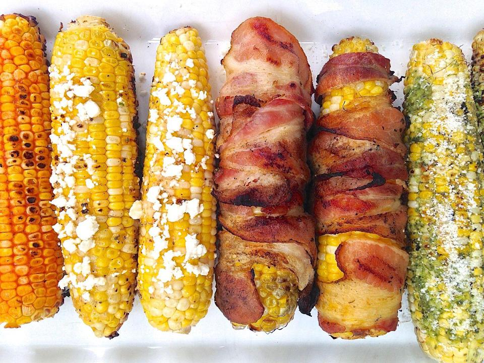 """<p>We've got six magical ways to top grilled corn—and bacon-wrapped isn't even the best one.</p><p>Get the recipe from <a href=""""https://www.delish.com/cooking/g3413/grilled-corn-ideas/"""" rel=""""nofollow noopener"""" target=""""_blank"""" data-ylk=""""slk:Delish"""" class=""""link rapid-noclick-resp"""">Delish</a>.</p>"""