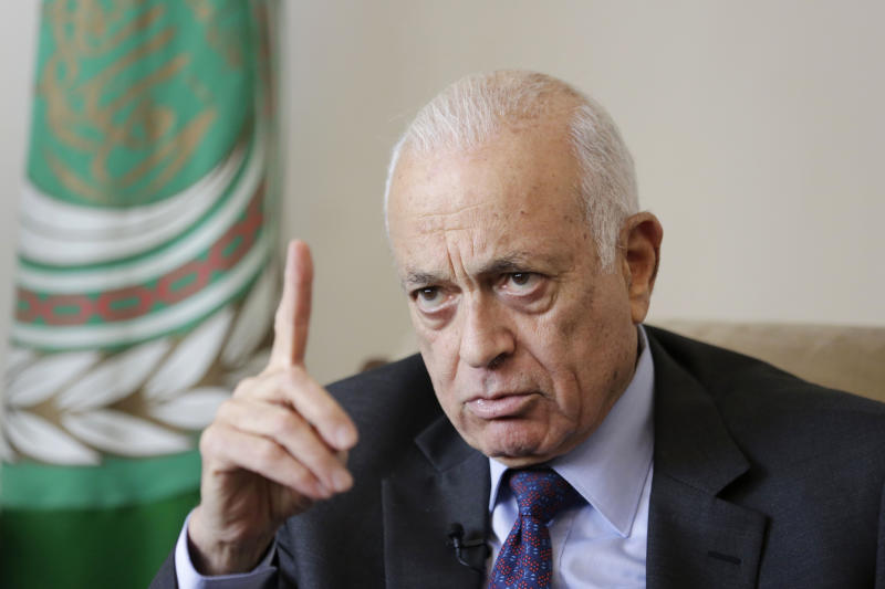"Arab League Secretary-General Nabil Elaraby speaks during an interview with the Associated Press, in Cairo, Egypt, Thursday, April 10, 2014. The head of the Arab League said Thursday he is confident that Israel and the Palestinians soon will resolve a crisis over the release of long-held Palestinian prisoners and extend their U.S.-brokered peace talks beyond an April deadline. Elaraby told The Associated Press that the April 29 deadline would be extended ""for months"" and rejected the idea that the talks have failed to make progress. (AP Photo/Hassan Ammar)"