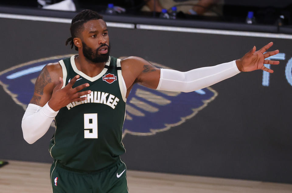 Wesley Matthews #9 of the Milwaukee Bucks reacts after hitting a three point basket  against the Dallas Mavericks during the fourth quarter at The Arena at ESPN Wide World Of Sports Complex.