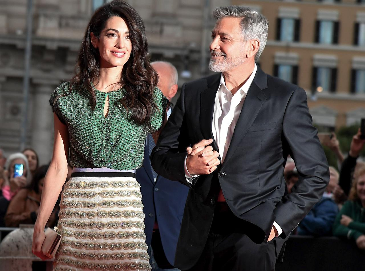 The human rights lawyer and mother of twins sparkled and shined when she accompanied her husband to the premiere of his <em>Catch-22</em>in Rome. Amal chose a beaded crop top and embroidered skirt by Giambattista Valli for the occasion.