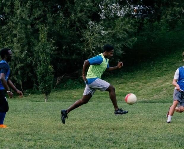 Scott, photographed here playing soccer, initially sacrificed a lot of his social life in order to pay off thousands of dollars in student debt.