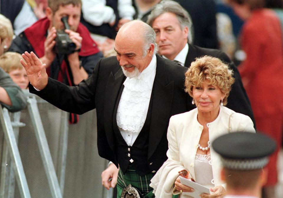 Sir Sean Connery with his wife Micheline at the opening of the Scottish Parliament in Edinburgh in 1999 (PA)