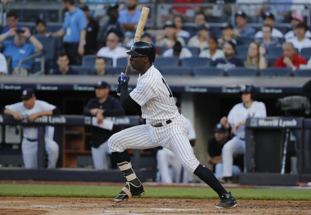 New York Yankees shortstop Didi Gregorius (18) connects for a base hit against the New York Mets during the first inning of a baseball game, Friday, July 20, 2018, in New York. (AP Photo/Julie Jacobson)