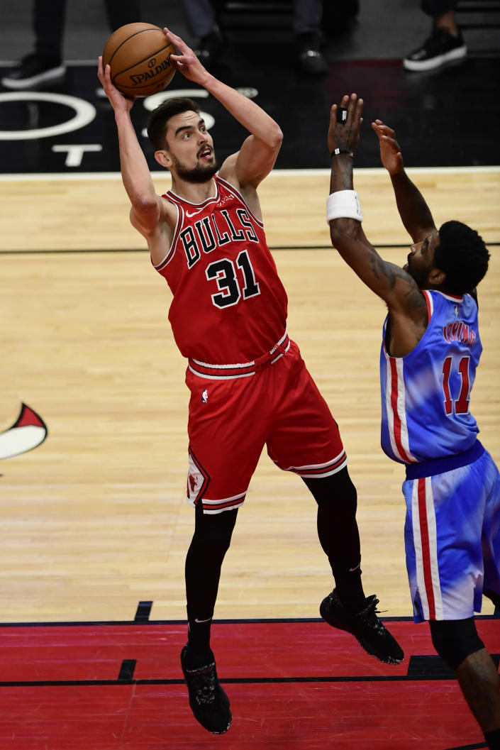 Chicago Bulls' Tomas Satoransky (31) of The Czech Republic, goes up for a shot against Brooklyn Nets' Kyrie Irving (11) during the first half of an NBA basketball game Sunday, April 4, 2021, in Chicago. (AP Photo/Paul Beaty)