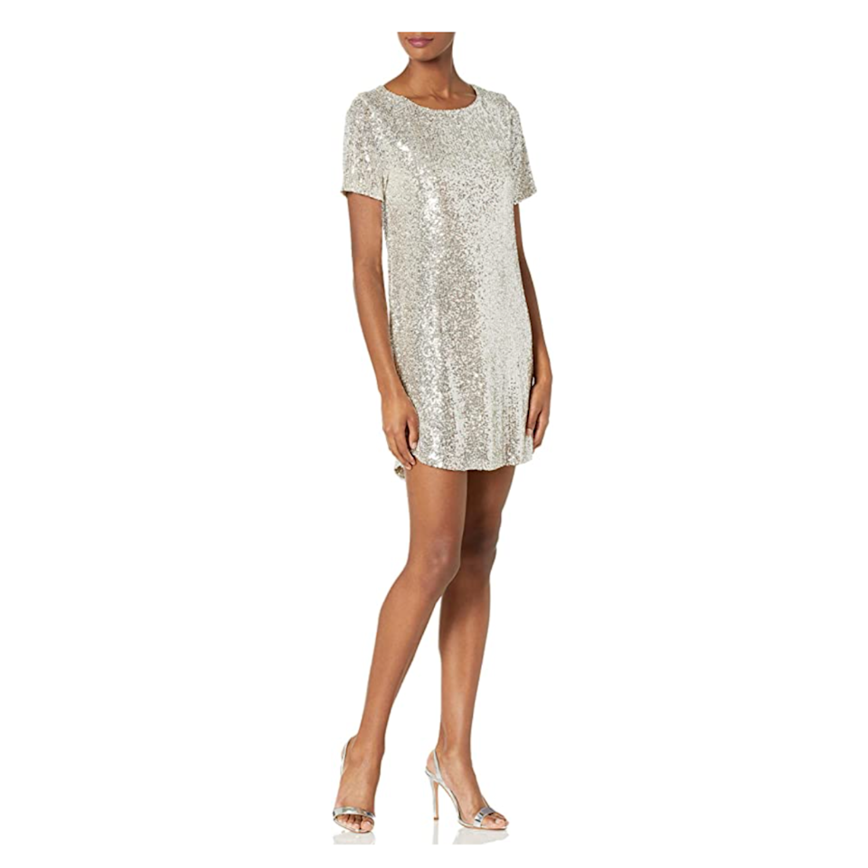 """A little glitter never hurts. Case in point: This short dress embellished with sequins, making it the glammed-up version of your favorite t-shirt dress. It's roomy enough for dancing—and literally looks like a party itself. $64, Amazon. <a href=""""https://www.amazon.com/BB-Dakota-Womens-Lights-Silver/dp/B08FF46RL1"""" rel=""""nofollow noopener"""" target=""""_blank"""" data-ylk=""""slk:Get it now!"""" class=""""link rapid-noclick-resp"""">Get it now!</a>"""