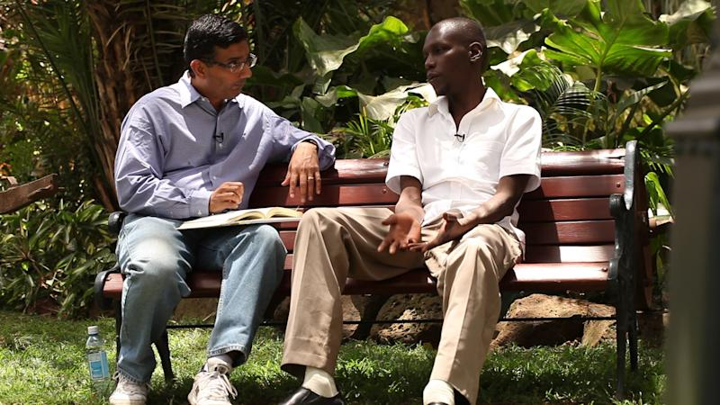 "This publicity image released by Rocky Mountain Pictures, shows an undated film clip of director, Dinesh D'Souza, interviewing George Obama in ""2016: Obama's America.""  Despite the unconventional release of ""2016: Obama's America,"" the movie is among the most successful political documentaries of all time and it doesn't show signs of cooling down ahead of the presidential election. (AP Photo/Rocky Mountain Pictures)"