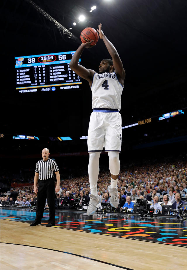 Villanova forward Eric Paschall shoots a 3-point basket during the second half against Kansas in the semifinals of the Final Four NCAA college basketball tournament, Saturday, March 31, 2018, in San Antonio. (AP Photo/David J. Phillip)