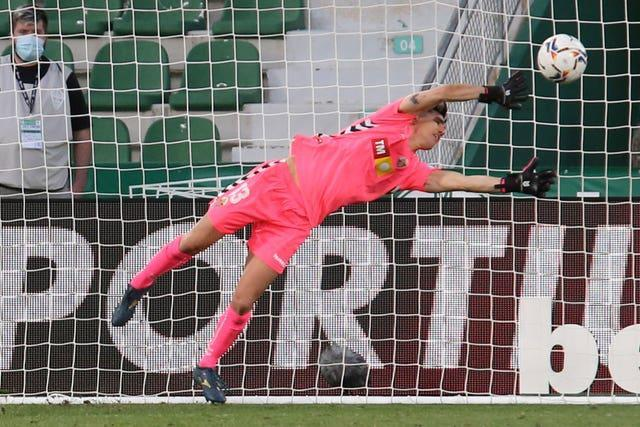 Elche keeper Edgar Badia  had worked hard to keep Barcelona at bay before being beaten a second time