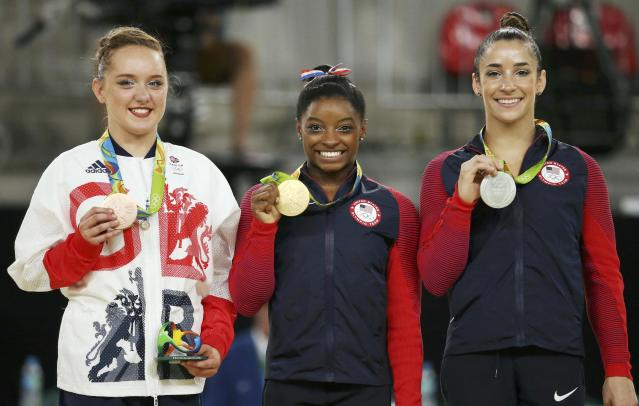 2016 Rio Olympics - Artistic Gymnastics - Final - Women's Floor Final - Rio Olympic Arena - Rio de Janeiro, Brazil - 16/08/2016. Gold medalist Simone Biles (USA) of USA, silver medalist Alexandra Raisman (USA) of USA (Aly Raisman) and bronze medalist Amy Tinkler (GBR) of Britain pose. REUTERS/Ruben Sprich FOR EDITORIAL USE ONLY. NOT FOR SALE FOR MARKETING OR ADVERTISING CAMPAIGNS.
