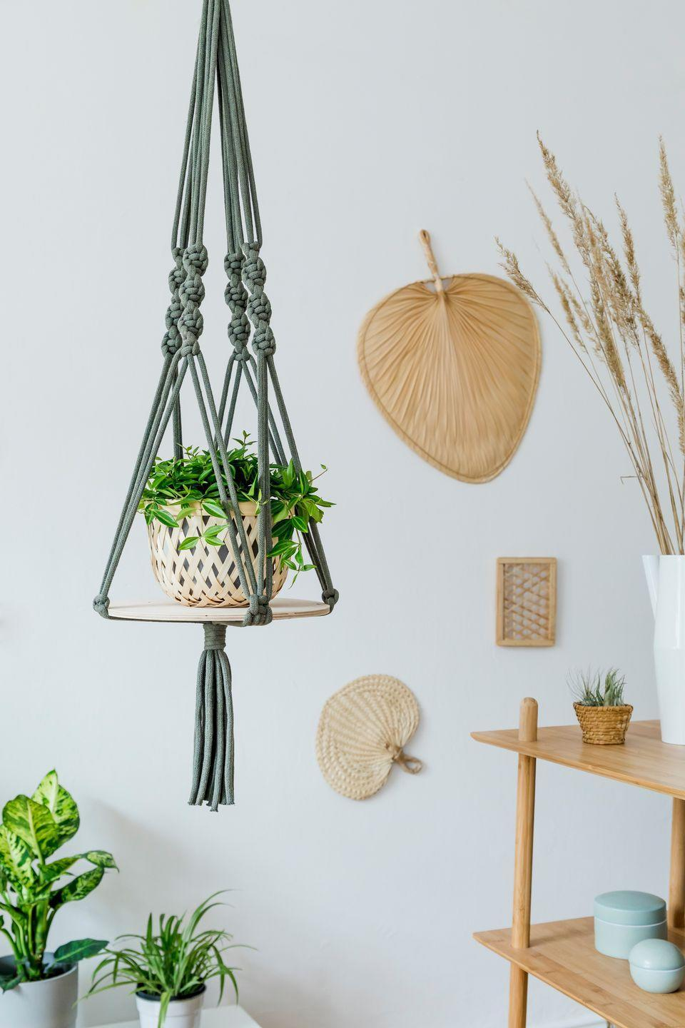 <p>Macramé, created by tying cords into knots, was all the rage in 70s homes, used for everything from potted-plant holders to decorative wall hangings in the shape of owls. </p>