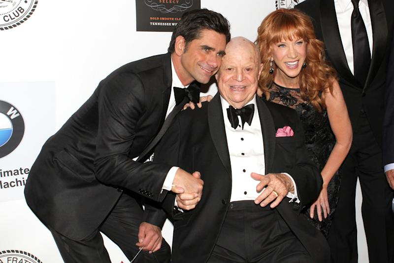 Actor John Stamos, honoree Don Rickles and comedian Kathy Griffin pose for photos at the Friars Club Roast of Rickles at the Waldorf Astoria on Monday, June 24, 2013 in New York. (Photo by Greg Allen/Invision/AP)
