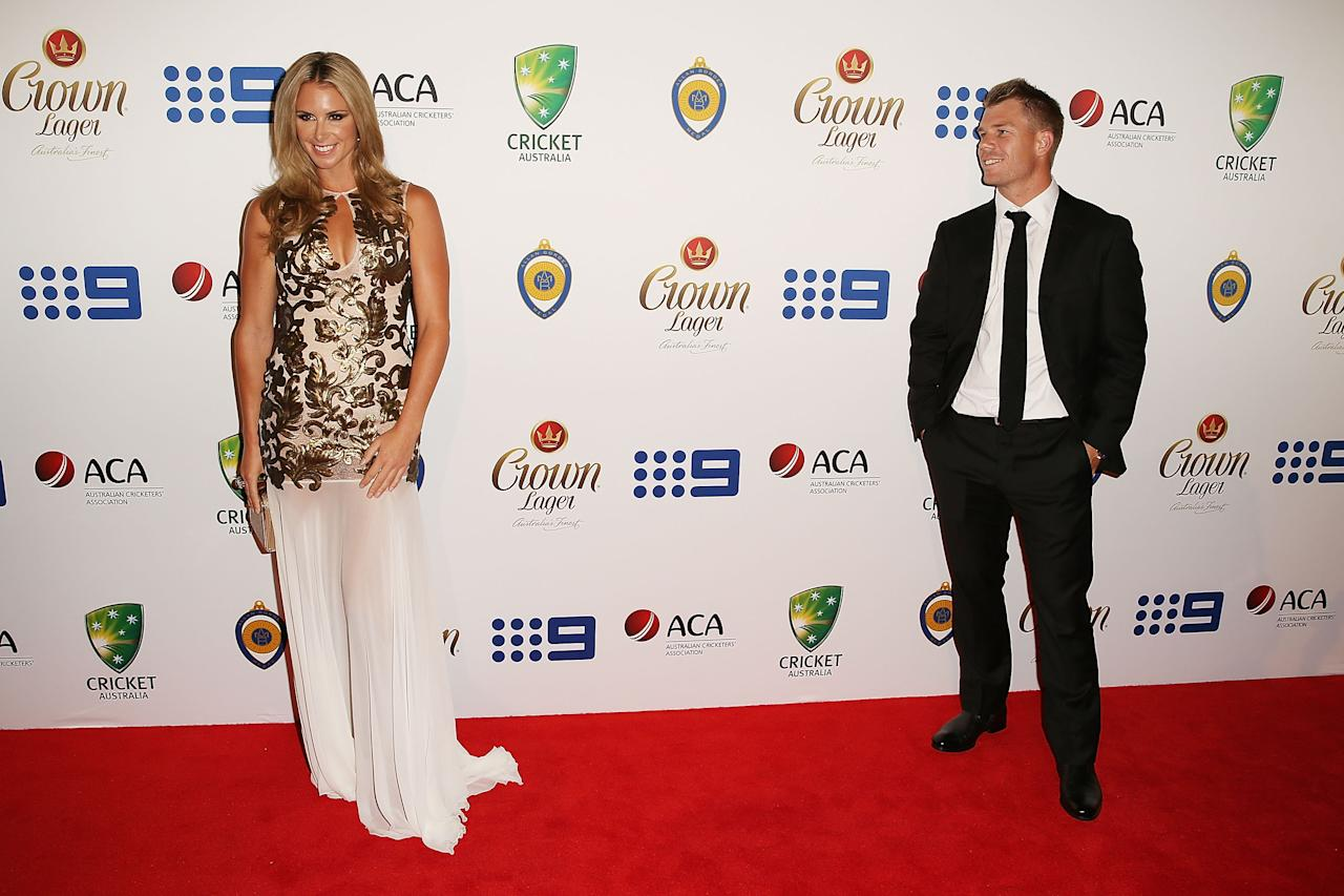 SYDNEY, AUSTRALIA - JANUARY 20:  David Warner and Candice Falzon arrive at the 2014 Allan Border Medal at Doltone House on January 20, 2014 in Sydney, Australia.  (Photo by Mark Metcalfe/Getty Images)
