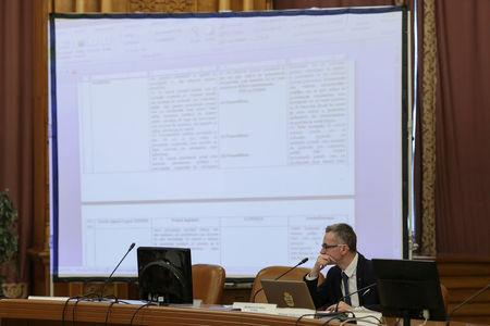 Member of the opposition Save Romania Union party, lawyer Stelian Ion, attends a meeting of the parliamentary committee aiming to modify the justice laws
