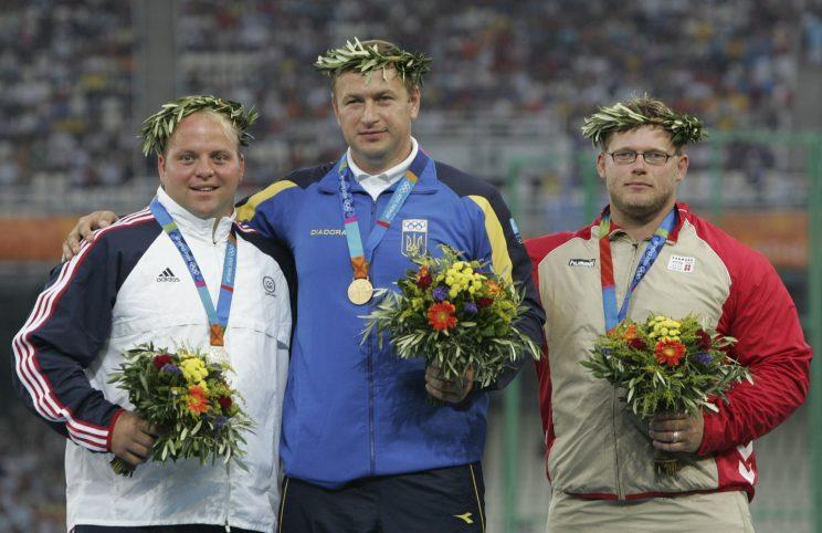 Adam Nelson, left, won silver at the 2004 Games only to be awarded gold almost a decade later. (AP)