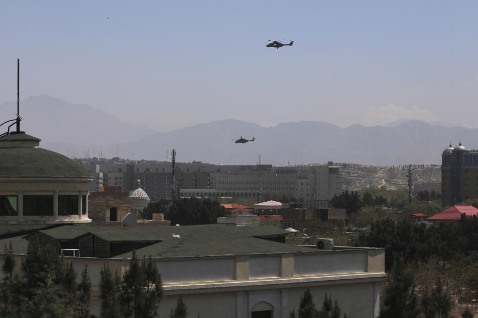 U.S. Black Hawk military helicopters fly over the city of Kabul, Afghanistan, Monday, April 19, 2021. (AP Photo/Rahmat Gul)