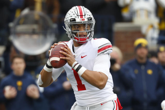 Ohio State quarterback Justin Fields throws against Michigan in the first half of an NCAA college football game in Ann Arbor, Mich., Saturday, Nov. 30, 2019. (AP Photo/Paul Sancya)
