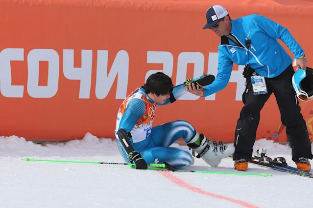 SOCHI, RUSSIA - FEBRUARY 19: Sung Hyun Kyung of Korea is helped from the floor during the Alpine Skiing Men's Giant Slalom on day 12 of the Sochi 2014 Winter Olympics at Rosa Khutor Alpine Center on February 19, 2014 in Sochi, Russia. (Photo by Alexander Hassenstein/Getty Images)