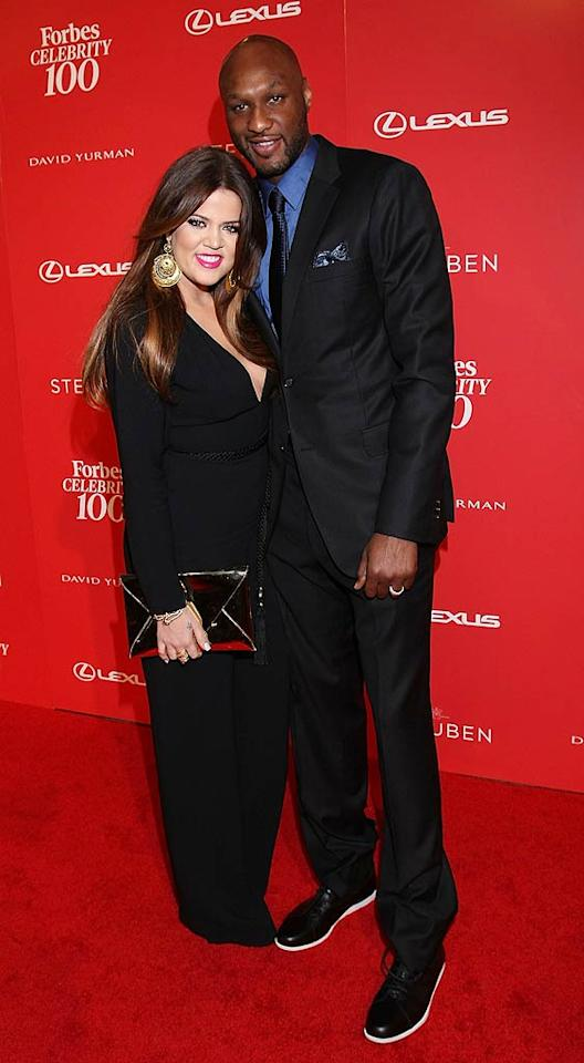 """Reality star Khloe Kardashian -- donning a Gucci jumpsuit -- and her husband, NBA star Lamar Odom, attended the Forbes Celebrity 100 Event, The Entrepreneur Behind the Icon, at Drai's Hollywood at the W Hotel on Wednesday night. The celebration paid tribute to celebrity entrepreneurs, and the Kardashian clan walked away with the Next Gen Entrepreneur award. Arnold Turner/<a href=""""http://www.wireimage.com"""" target=""""new"""">WireImage.com</a> - June 8, 2011"""