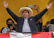 Peruvian presidential candidate Pedro Castillo at his party's headquarters in Lima after taking a razor-thin lead as the final votes are tallied in the run-off election Right-wing populist Keiko Fujimori and hardline leftist Pedro Castillo were neck-and-neck in a battle for Peru's presidency Monday as the crisis-hit nation's election looked set to go down to the wire.